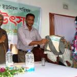 A rural women receiving best tax-payer reward organised by NRDS & Ewazbalia Union Parishad